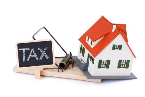 mengurangi pajak properti